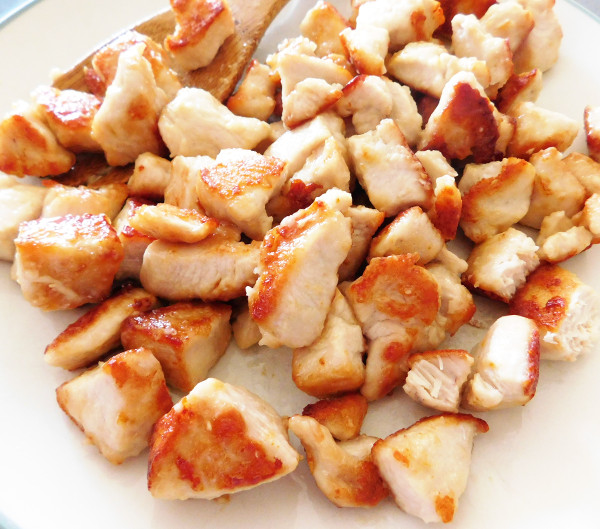 Cooked chicken on a plate.