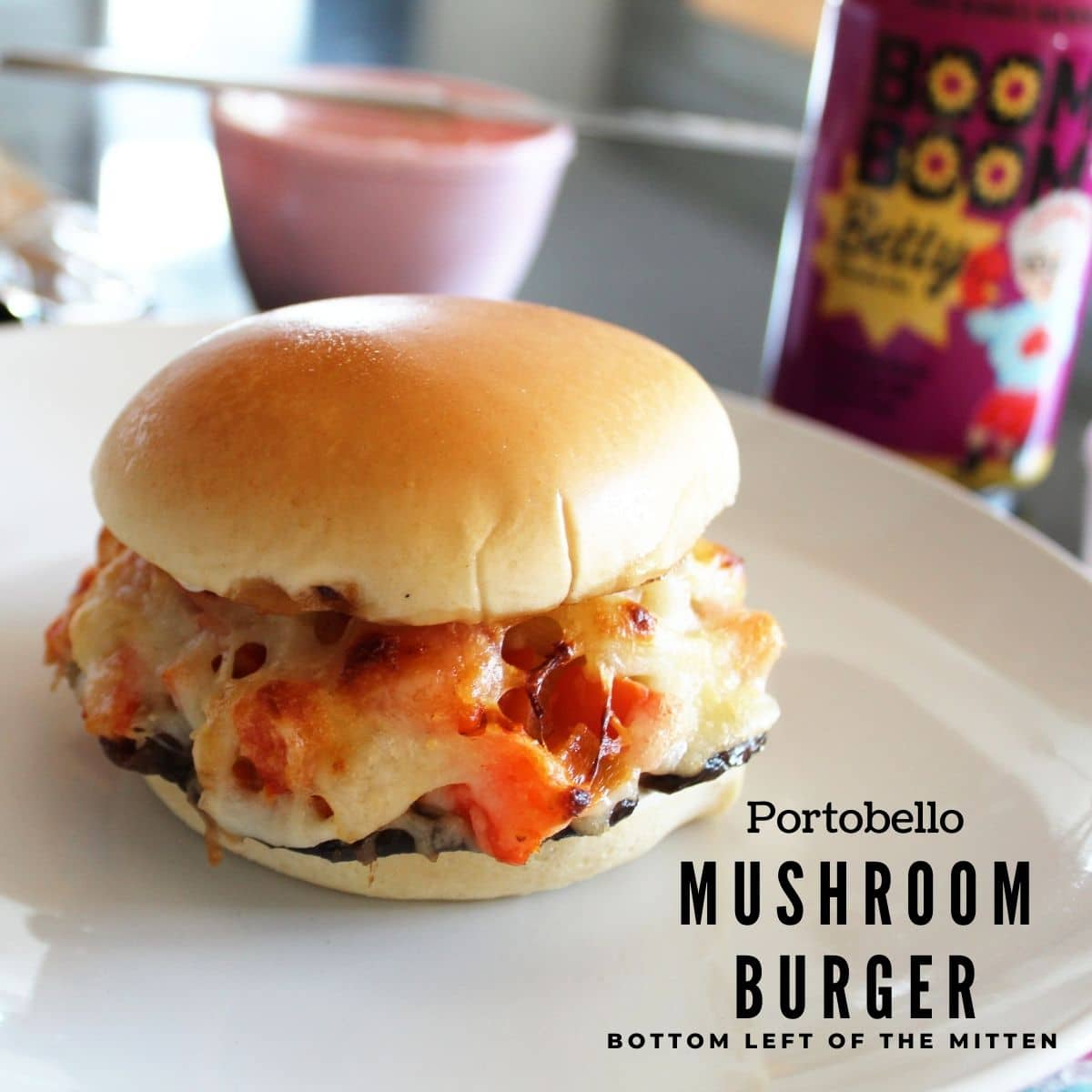 side shot of a portobello mushroom burger recipe with descriptive text overlay.