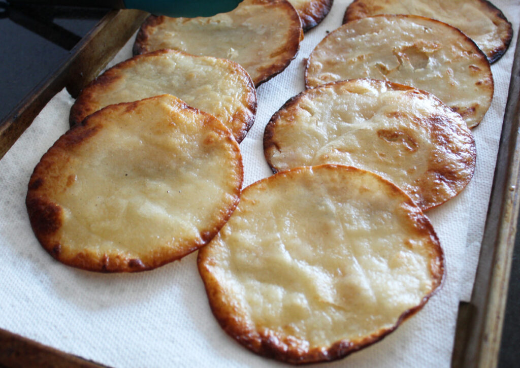 side shot of flour tortillas that have been fried