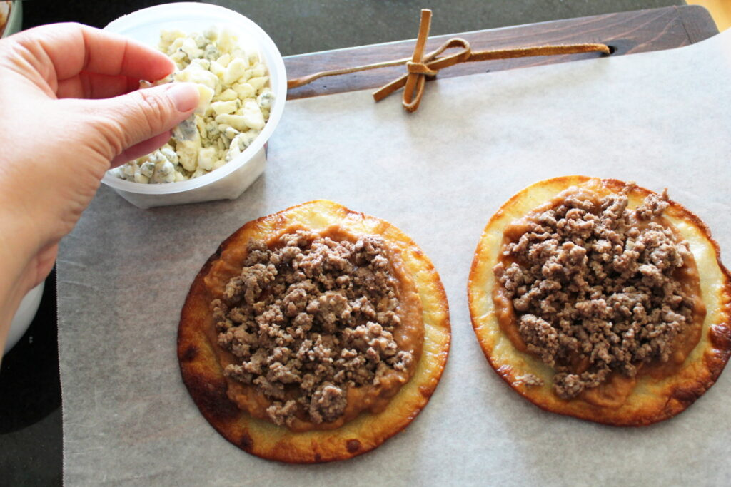overhead shot of tostadas and a dish of blue cheese off to the side