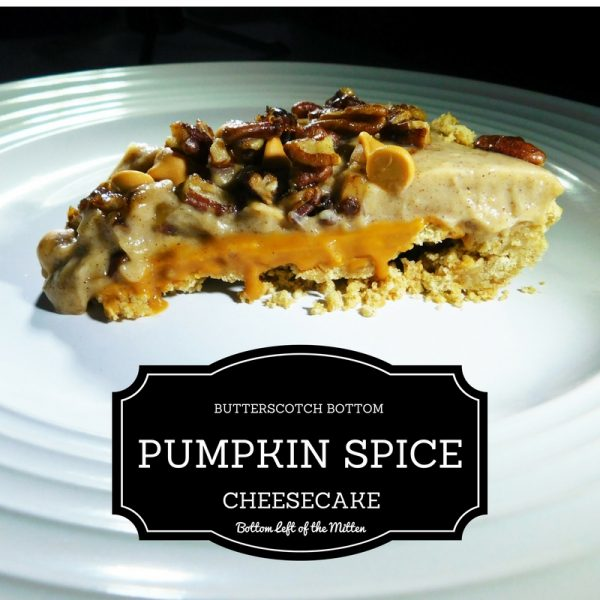 A slice of Butterscotch Bottom Pumpkin Spice Cheesecake on a plate ready to eat!