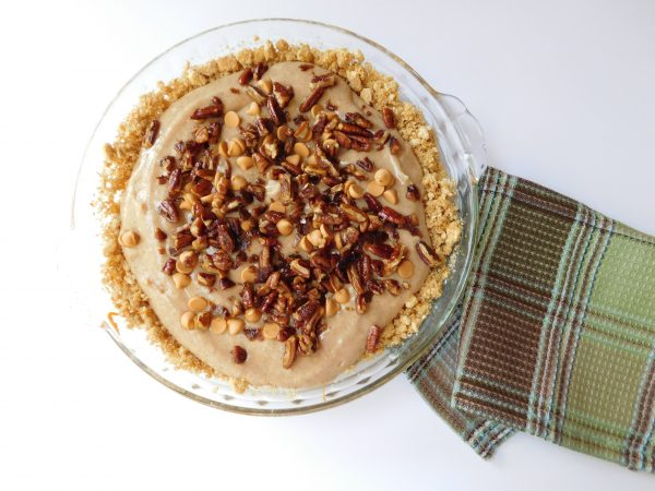 A Butterscotch Bottom Pumpkin Spice Cheesecake in a pie plate ready to eat!