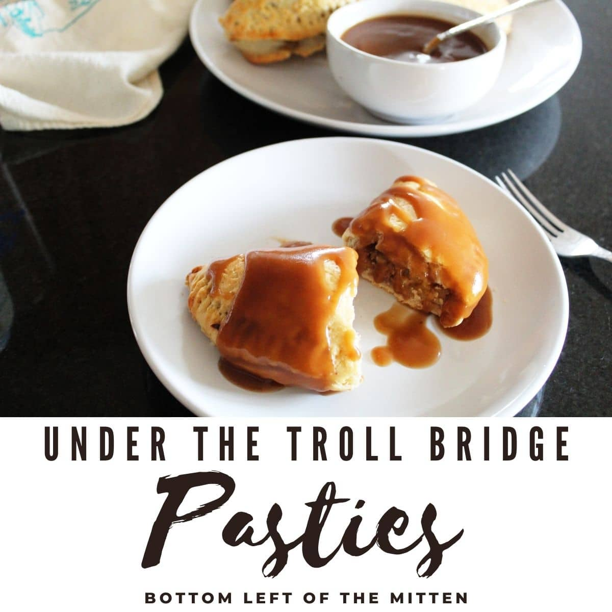 Under the Troll Bridge Pasties with brown gravy drizzled over them.