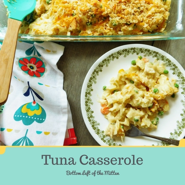 Tuna casserole served on a plate and in a casserole dish in the background.