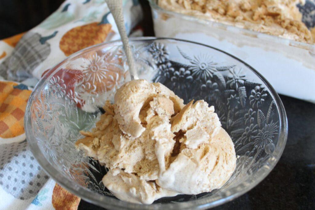 scooped pumpkin ice cream in a bowl.