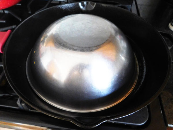 Cap over cooking burgers in skillet