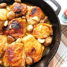 Overhead shot of Skillet Chicken, Mushrooms & Garlic. with a craft beer off to the side.