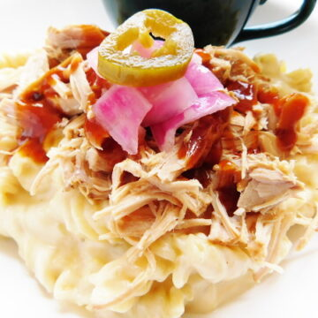 Pulled Pork Mac and Cheese has a creamy homemade sauce topped with tender pulled pork and BBQ sauce. The perfect meal for when your craving cheesy goodness. | Bottom Left of the Mitten