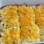 hash brown casserole recipe in a casserole dish shot from side view.
