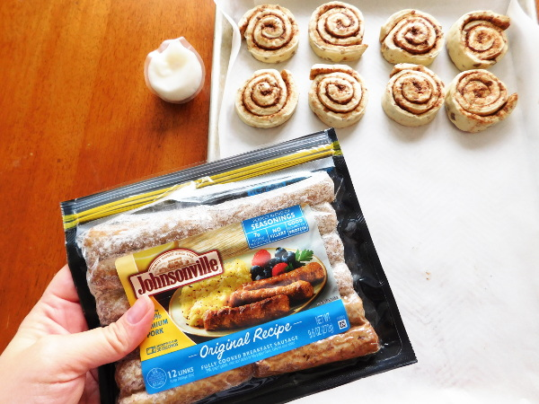 Cinnamon Rolls on a cookie sheet and a package of sausage.