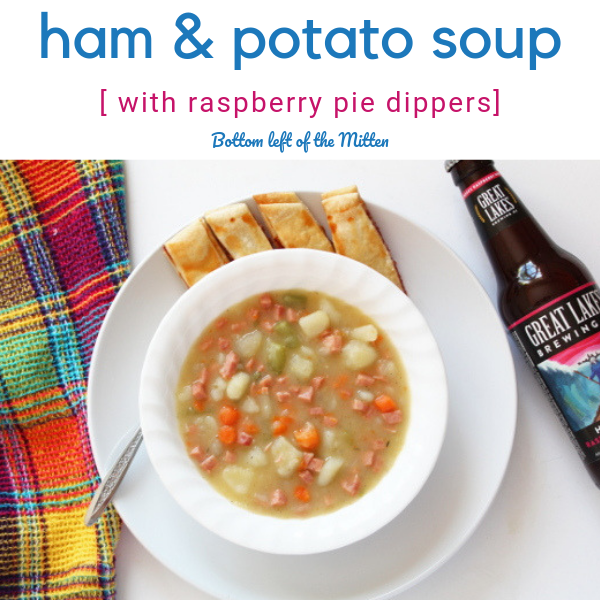 Ham and potato soup in a bowl with raspberry pie dippers and a craft beer off to the side.