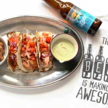 Salmon Tacos paired with craft beer and avocado ranch dressing