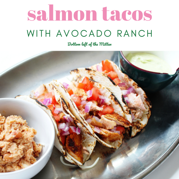 Delicious Salmon Tacos with a side of refried beans and avocado ranch