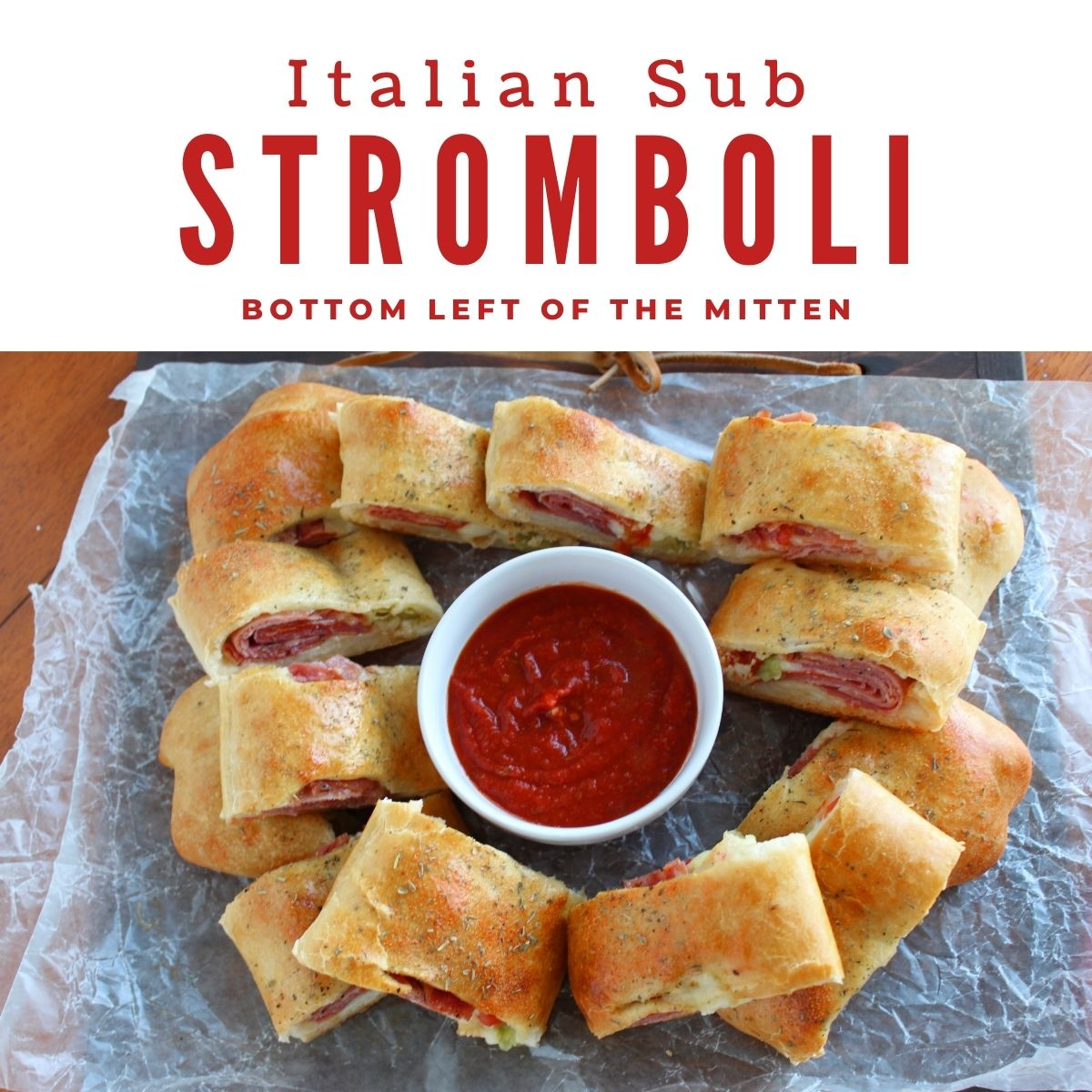 Italian Sub Stromboli ready to eat with pizza sauce for dipping with descriptive text overlay.