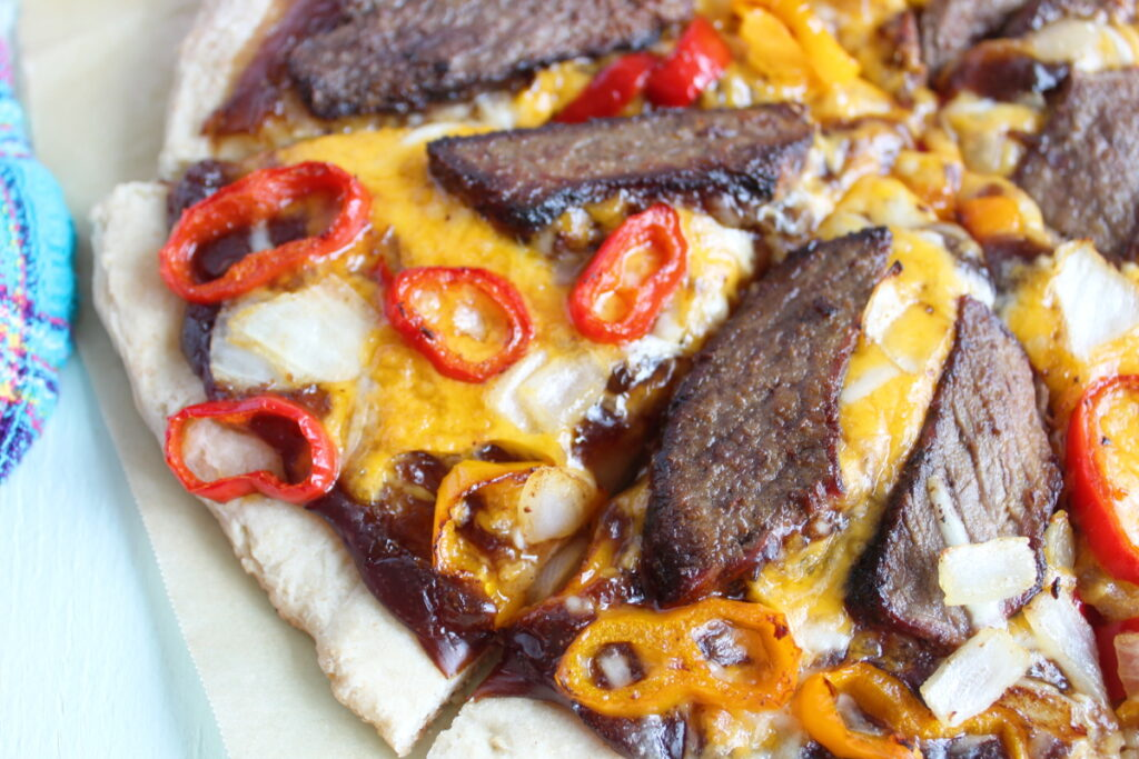 Closeup of a steak pizza
