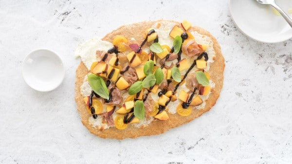 overhead shot of Peach and Prosciutto Pizza Caprese