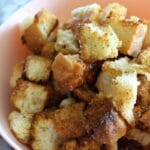 side view of air fryer ranch croutons in a bowl