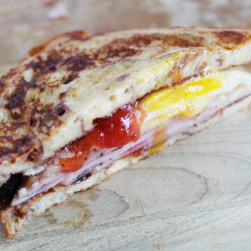 side shot of a Monte Cristo breakfast sandwich cut in half