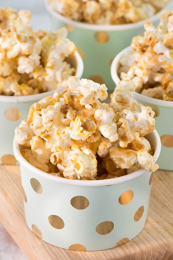 side view of cups of sweet popcorn