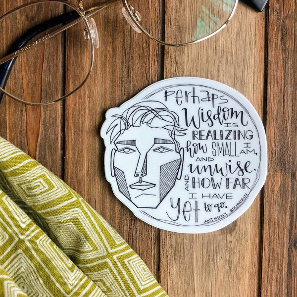 a vinyl sticker with an Anthony bourdain quote on it