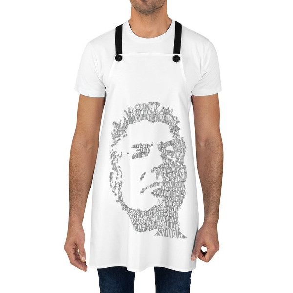 a man wearing an apron with a photo of anthony bourdain on it