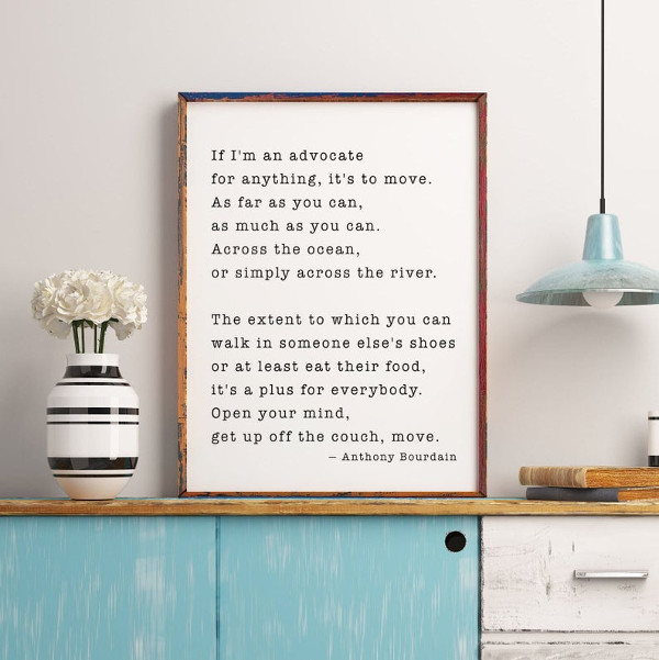 an art print with a quote from anthony bourdain