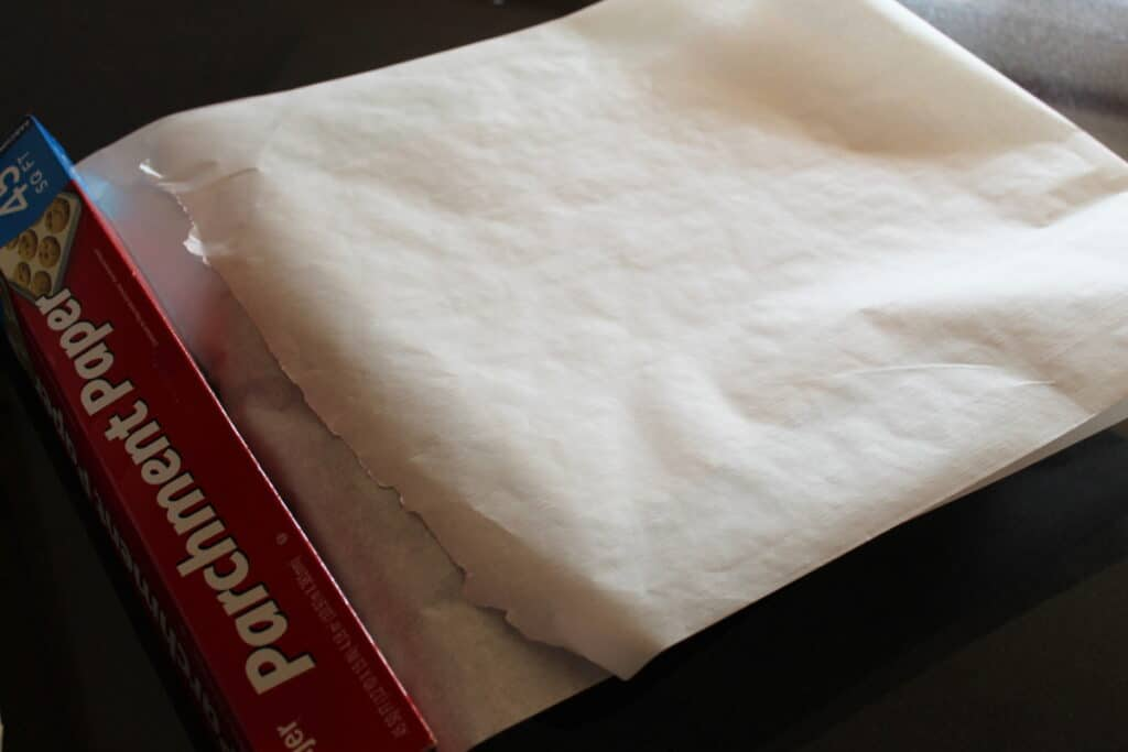 parchment paper folded over in a baking dish