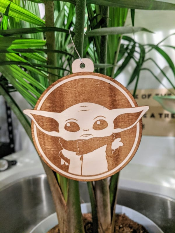 side shot of a Baby Yoda Ornament on a tree