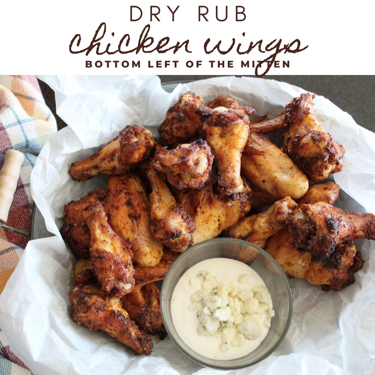 Dry Rub Chicken Wings in a basket with blue cheese dressing and a craft beer to the side.