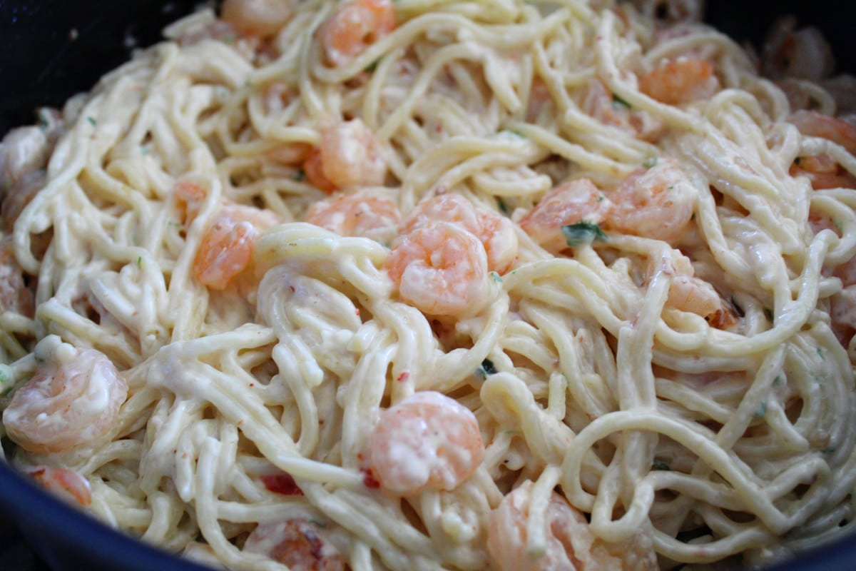 Creamy Shrimp and Pasta in a pan ready to eat.