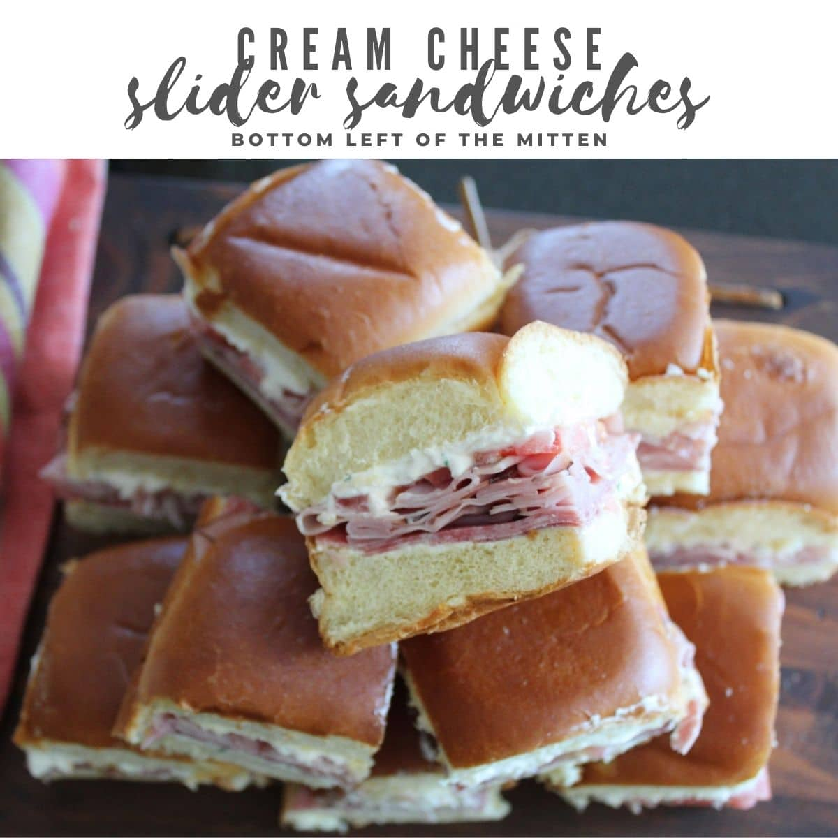 overhead shot of cream cheese slider sandwiches stacked on top of each other with descriptive text overlay.