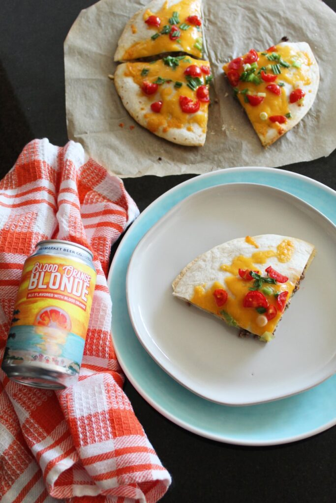 staged shot of tortilla pizza with craft beer pairing.