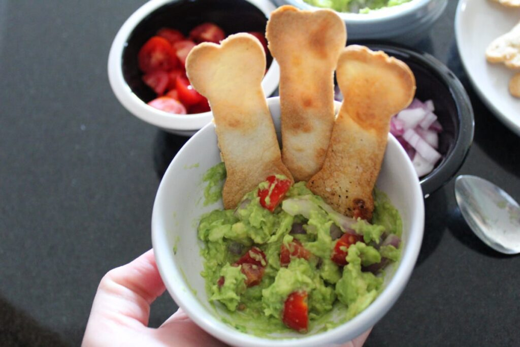mashed avocados with baked tortilla chips.