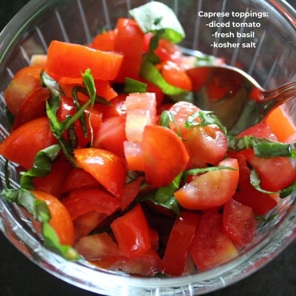 overhead shot of simple tomato and basil salad with descriptive text overlay.